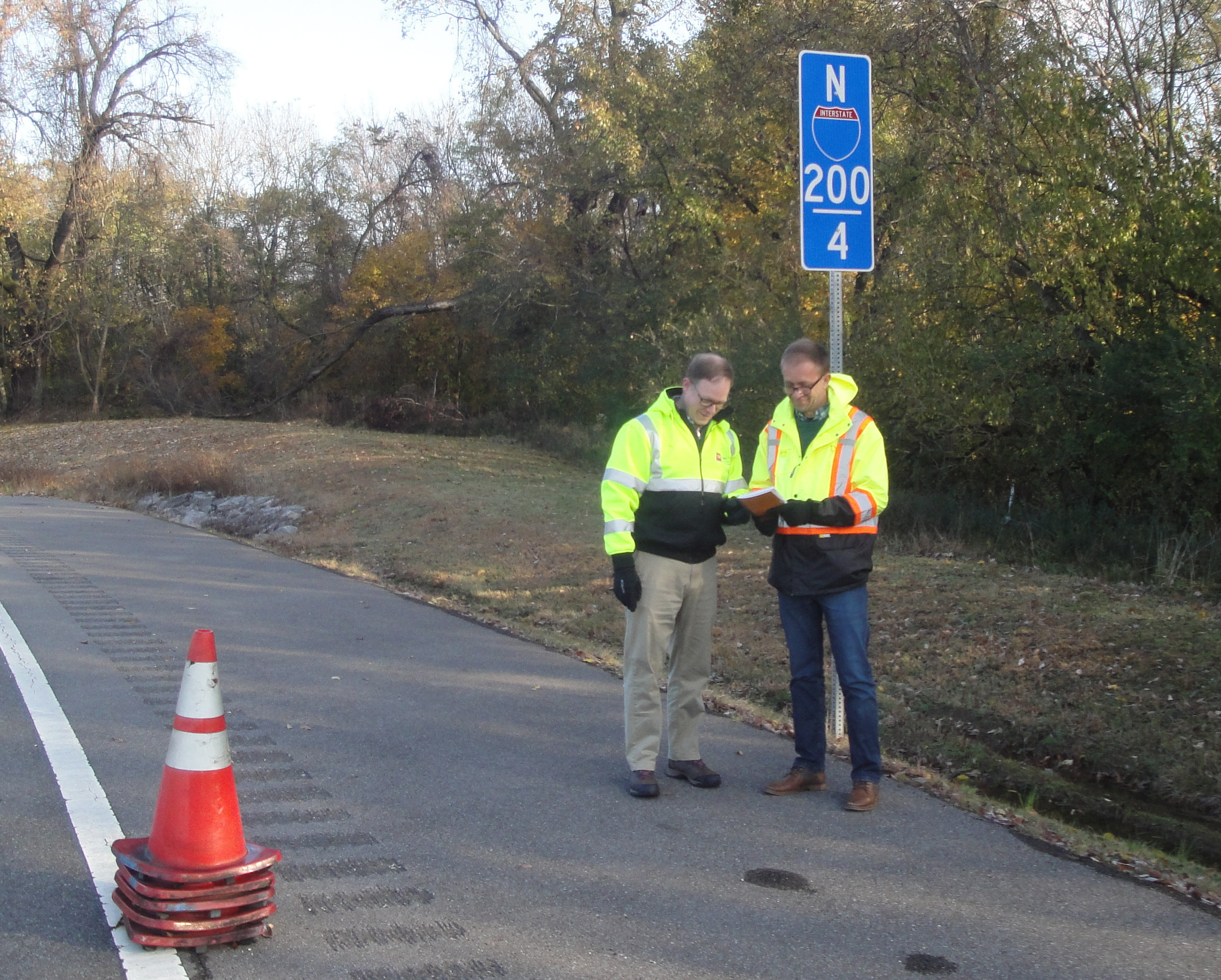 Matt Cate and Airton Kohls checking setup with the MUTCD